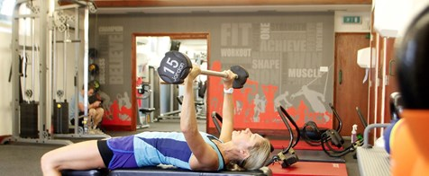 A woman bench pressing weights