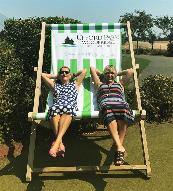 Two people in a giant deck chair
